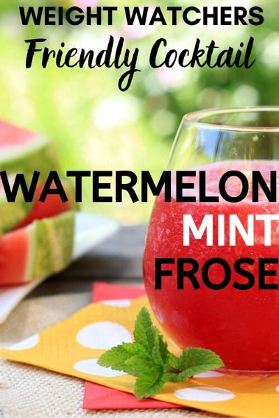 Picture of a Stemless Wine Glass of Watermelon Mint Frosé - Weight Watchers Friendly Alcoholic Beverage on table with a sprig of fresh mint
