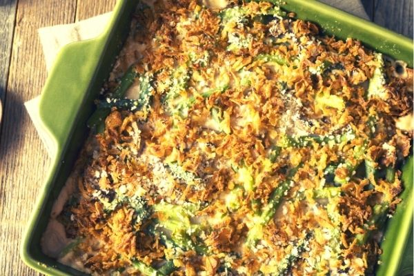 Healthy Velvety Green Bean Casserole baked inside of green pan