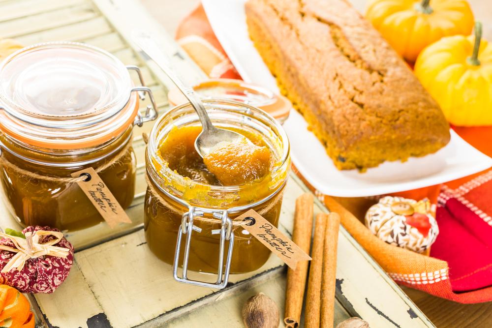 Pumpkin Butter in a glass jar with cinnamon sticks along side of jar