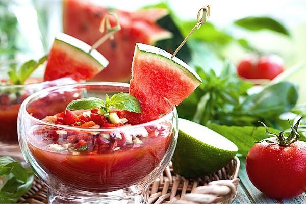 watermelon gazpacho weight watchers recipe in a glass bowl on a rattan server