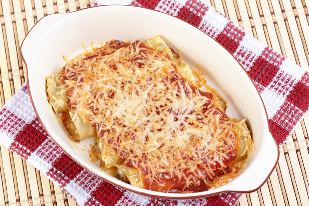 Cheesy Chicken Manicotti with chicken and 3 different cheeses baked in a meaty tomato sauce