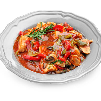 Chicken cacciatore in plate isolated on white