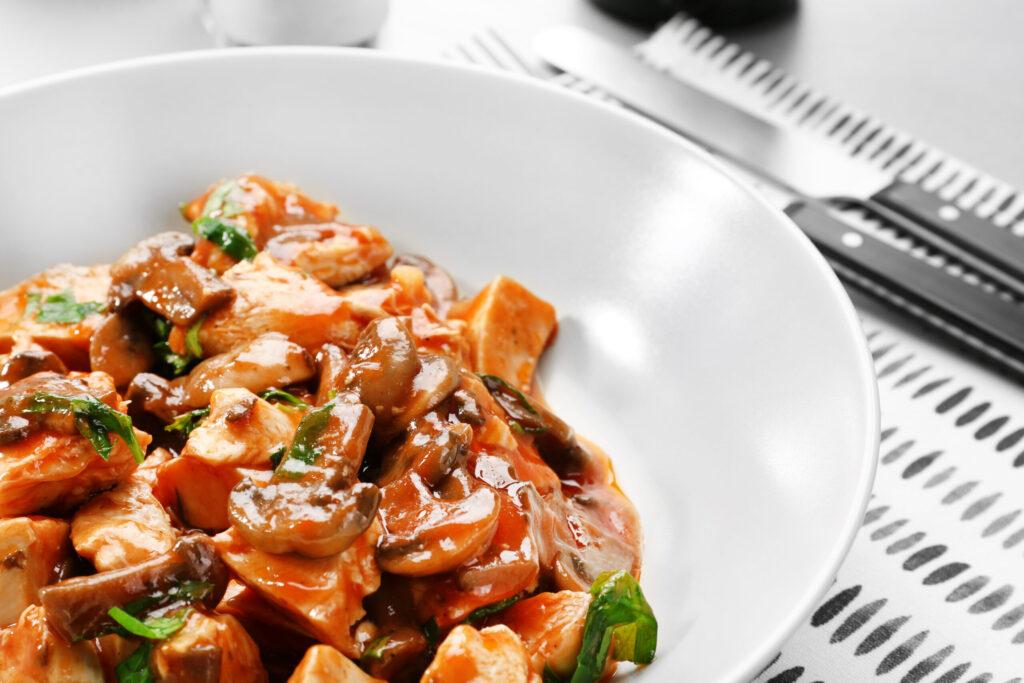 Stovetop Chicken Cacciatore in White Bowl using healthy chicken breast in the recipe