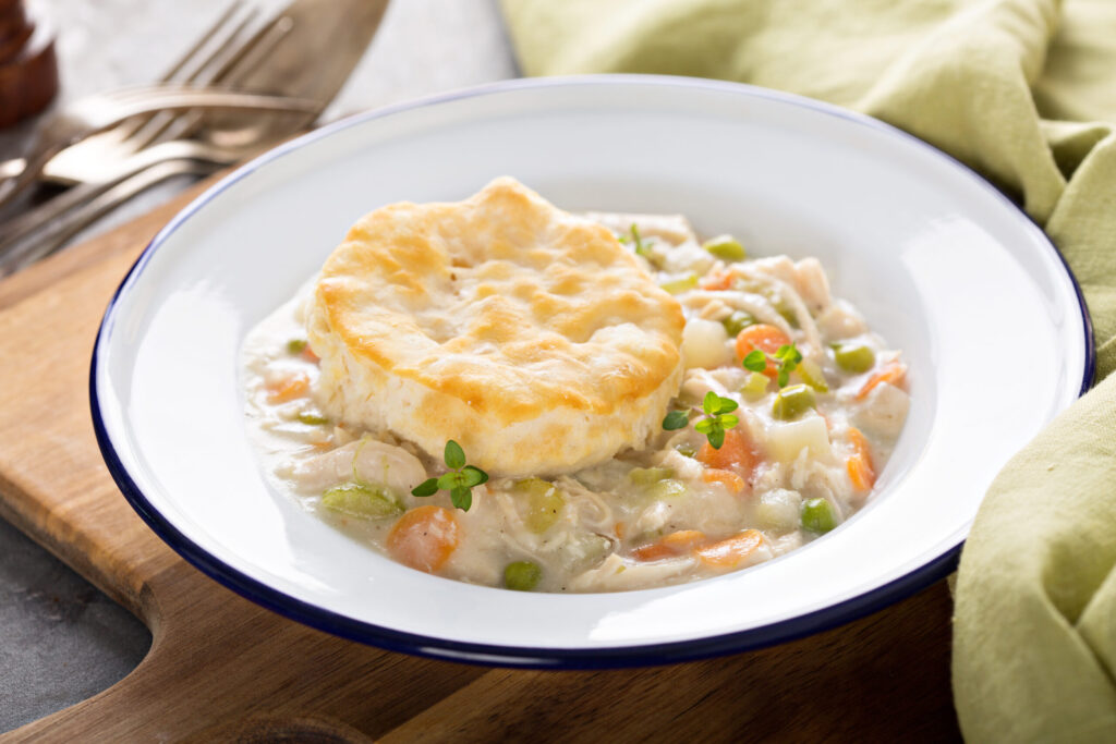 Healthy Chicken Pot Pie with Biscuits in white bowl