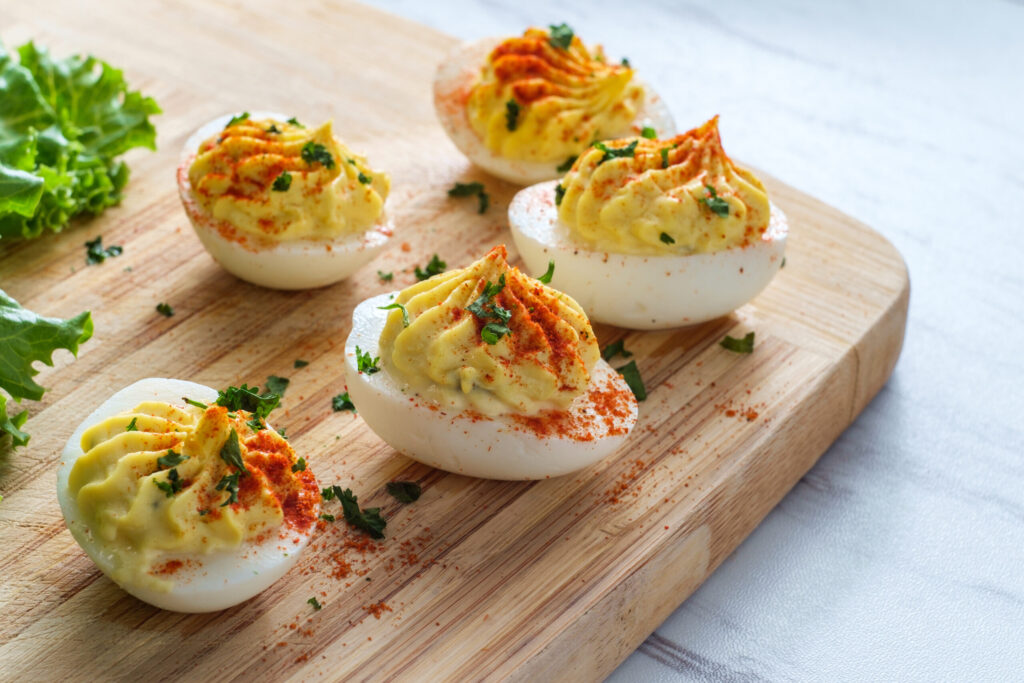 Instant Pot Spicy Deviled Eggs topped with parsley and paprika