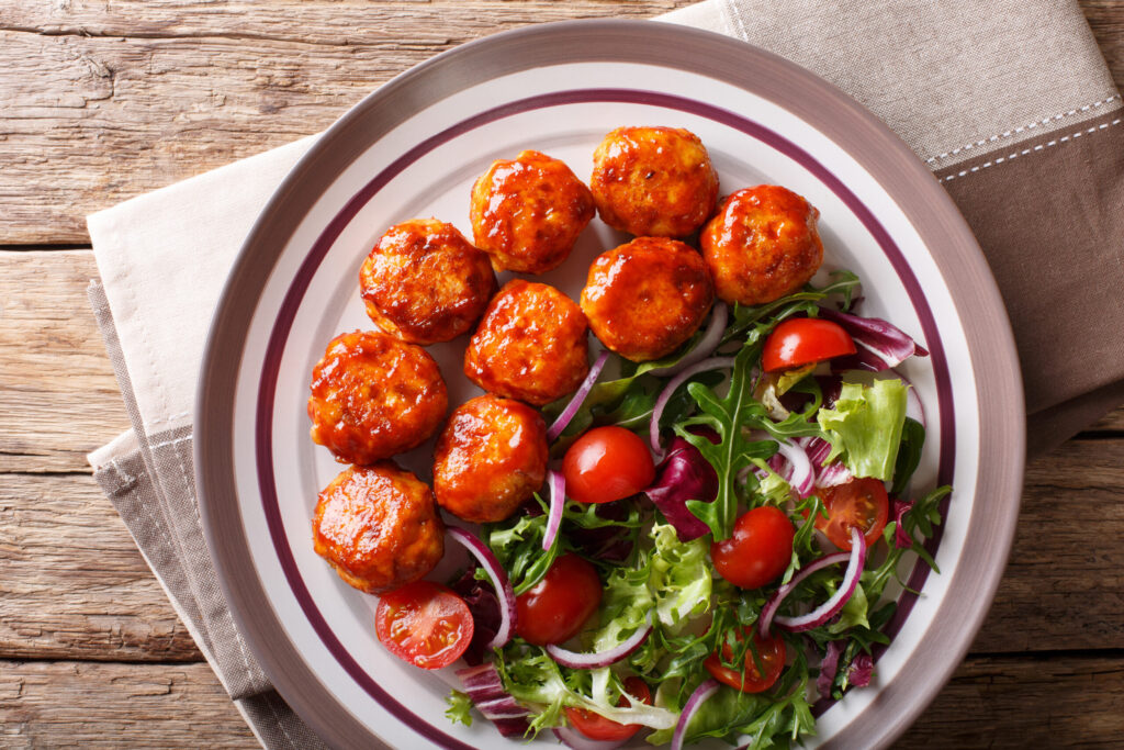 Copycat Pioneer Woman Whiskey Glazed Meatballs Lightened Up on White Dinner Plate with Salad
